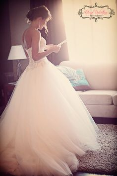 Bride reading a letter from groom, the morning of the wedding! that dress!!!