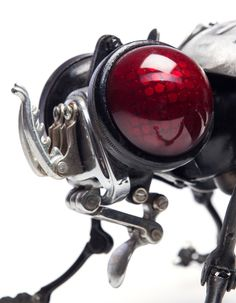 French artist Edouard Martinet assembles faithful interpretations of birds, crustaceans, insects, and other creatures with countless objects from discarded bicycles, cars, and household objects. A bicycle pump forms the abdomen of a dragonfly, windshield wipers serve as the legs of a fly, or the