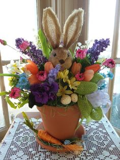 "This is one of my bright Easter creations that's sure to make everyone smile. Visit my Etsy shop or FB page, ""DCM Floral Designs"" for my new spring and Easter offerings. Easter Projects, Easter Crafts, Holiday Crafts, Easter Ideas, Valentine Crafts, Spring Crafts, Easter Flower Arrangements, Easter Flowers, Craft Flowers"