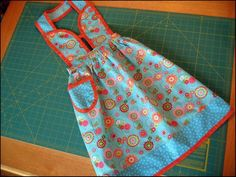 Sewing: Child's Apron.  I love the different bodice on this apron! // matching aprons for me and my girl?? :-)