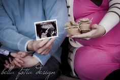 Mommy and Daddy with ultrasound photos and baby booties - maternity photo ideas