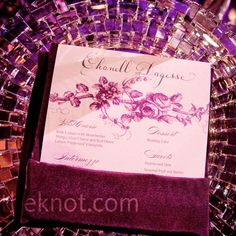 Email    Purple Place Settings    Floral-patterned menu cards were slipped into the napkins and set atop the cut-crystal chargers.