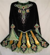 Though earlier traditional styles were simpler, this is a beautiful example of today's intricately worked designs on an Irish dance costume, based on ancient celtic knot patterns, scrolls and legendary symbols.