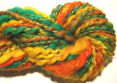 handspun art yarn Daylily thick and thin by SpinningWheelStudio, $24.00