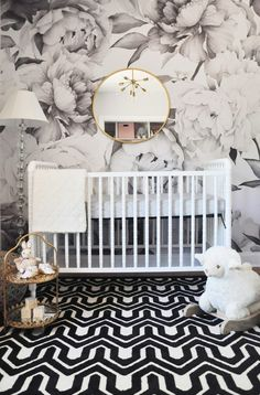black and white nursery with floral wallpaper accent wall. In the Nursery with Foxy Oxie