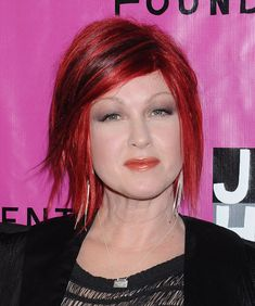 short red hair with 1930s eyebrows--you rock Cyndi Lauper!