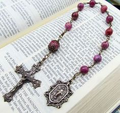 Silver Plate Rosary Bracelet features 6mm Garnet Fire Polished beads The Crucifix measures 5//8 x 1//4 The charm features a Holy Family medal.