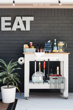 DIY a grill cart on wheels for ultimate outdoor entertaining. Adding hooks and baskets keeps grilling utensils and accessories organized.