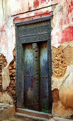 An old door on a on a street in Bagamoyo, Tanzania
