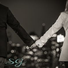 ring_holding_hands_LOVE_ENGAGEMENT_SESSION_LOVE_JUNKIES_NIGHT_LIGHTS_STREET_SCENE_SARAH_GAYLOR_PHOTOGRAPHY_NEW_YORK_CITY