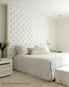 The headboard is lovely and the bed spread with its edge piping and box pleats is charming.