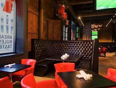 Love the red leather and black leather seating - Red Card Sports Bar + Eatery, Vancouver, BC