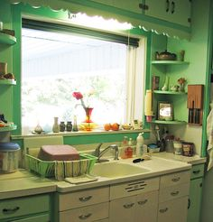 Our kitchen wall looks a lot like this--saving the idea for keeping part of the cabinets white