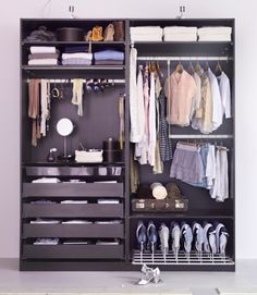 Ikea Pax with drawers for jewelry, scarves, belts, etc. and shoes, plus all my everything else. YES. YES. YES.