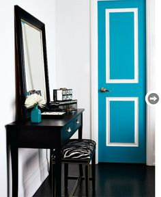 """Welcoming entryway  Homeowner and designer Stacey Cohen treated the closet door to a dose of vibrant turquoise in an eggshell finish. To create contrast, its grooves were coated in a semi-gloss white: """"It's a nice way to make a statement and introduce colour in a less overbearing way,"""" she says."""