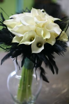 White calla lilies and black feathers