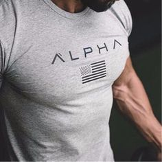 Men's athletic fitness T-shirt with great perspiration technology and durability. Crossfit Shirts, Statement Tees, Gym Wear, Powerlifting, Physical Fitness, How To Stay Healthy, Gym Workouts, Black Men, Shirt Designs