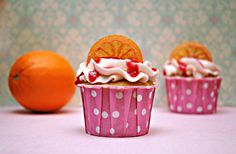 champagne cupcakes with blood orange filling and sugared orange slices. just act like you don't want these.