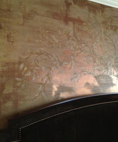 Custom designed arched stencil for above a king size headboard. Modern Masters Metallic Plaster and Bronze foil. By Tracy Wade Design, LLC.