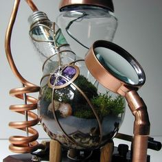 "Professor Alexander's Botanical Vasculum – Steamed 300 watt Moss Terrarium from Etsy seller SteamedGlass is a beautiful blown-glass steampunk Rube Goldberg terrarium: ""This is the…"