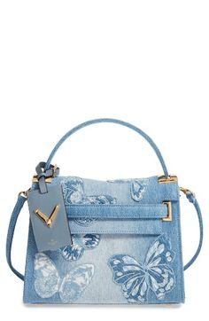 Free shipping and returns on Valentino Small My Rockstud Denim Satchel at Nordstrom.com. Pre-order this style today! Add to Shopping Bag to view approximate ship date. You'll be charged only when your item ships.Signature rockstud hardware beautifully contrast with the intricate butterfly embroidery on this structured, faded-denim handbag. An optional shoulder strap and removable hand strap provide multiple styling options.