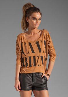 TORN BY RONNY KOBO Mandy Long Sleeve Ca Va Bien Tee in Camel at Revolve Clothing - Free Shipping!