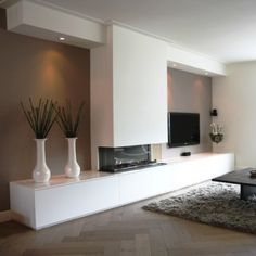contemporary fireplace wall with television and lighted accent