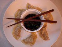 Steamed pork dumplings with dipping sauce