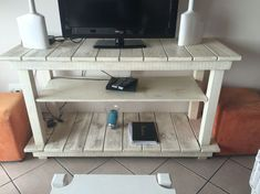 Do you already have ideas for your weekend project? How about replacing your old TV stand with a new one? Check out these 11 very different, but incredible DIY TV stand project ideas that step you through building a terrific media console. Pallet Furniture Designs, Wooden Pallet Furniture, Tv Furniture, Farmhouse Furniture, Furniture Projects, Wood Pallets, Living Room Furniture, Pallet Walls, Furniture Dolly