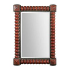 Uttermost 13869 Clancy Rust Red Decorative Mirror  Clancy Rust Red Decorative MirrorHeavily distressed, carved wood frame with a rust red finish accented