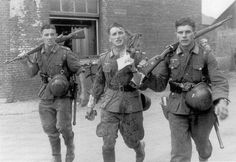 Three German soldiers returning from a recent fight. The officer in the middle has been wounded (note the blood stains and the very agitated look in their eyes). They don't seem to like being photographed at this very moment. Definitely not a staged photograph. Location unknown.