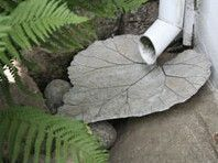 Cement/Hypertufa leaf as a more attractive base of a downspout or a rain chain.