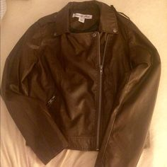 Women's Brown Faux Leather Jacket Celebrity Pink brand faux leather jacket!! I received it as a gift, and it just isn't my style. I never wore it, so it is in perfect condition, but because it was a gift, the tags were removed so I cannot list as new with tags. The front zips, and has two zip pockets! This would be an awesome holiday gift!! Let me know if you have any questions!  Open to negotiations!! Celebrity Pink Jackets & Coats