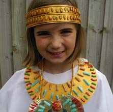 Ancient egyptian collar, scarab necklace, and head dress