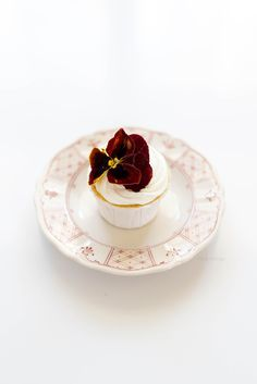 must try; the richest, moistest, buttermilk yellow cupcakes made with butter and oil; filled with rich homemade passion fruit curd; topped with a mascarpone whipped cream
