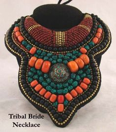 Contemporary necklace made in Sikkim | Turquoise, coral, seed bead and copper with a silver and turquoise inlaid medallion.