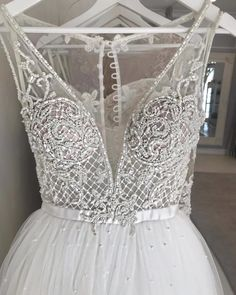 This sleeveless bridal gown has beautiful beaded detail on the bodice. Get custom #weddingdresses like this made in a price range you can afford. Our US firm also provides inexpensive #replicas of haute couture designs for brides on a budget. Email us your images for pricing. DariusCordell.com