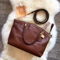 Coach Kelsey Crossbody in Chestnut Beautiful bag, only used a few times and in great condition! This Coach Kelsey Crossbody bag has pebble leather with a deep redish-orange interior, gold hardware and is a hard to find color! Has a detachable crossbody strap so it can be also used as a satchel. Has one zippered interior pocket and two open ones. The interior is in perfect condition. Exterior has a few tiny nicks on the hardware. If you need any additional picture please let me know. No…