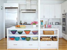Sleek appliances, plain-fronted white cabinetry and pops of color in the accessories are essential to keeping this kitchen simple and chic. myhomeideas.com