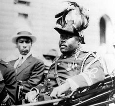 Marcus Garvey is shown in a military uniform as the 'Provisional President of Africa' during a parade on the opening day of the annual Convention of the Negro Peoples of the World along Lenox Avenue in Harlem borough of New York in 1922