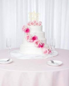 White horizontal lined tiers with fresh pink roses