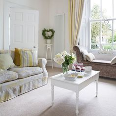 White and pale yellow living room   Living room decorating   25 Beautiful Homes   Housetohome.co.uk