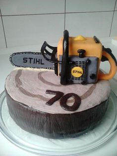 Tyler would love this cake.. Stihl chain saw