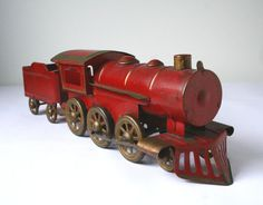 Antique red tin steam engine train and coal by cristinasroom