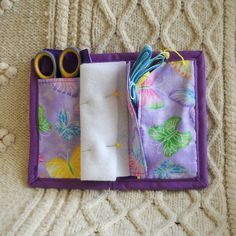 This classic needle book is as fresh as a spring day with its design of butterflies on a sparkling purple background. The cotton fabric is reinforced with fusible batting to make it long-lasting and is lined and edged with dark purple. It measures 6 x 8 when open and closes to 4 x 6, small enough to carry in a purse or tote bag. Inside are two pockets, 3 x 5 and 3 x 5 1/2 for holding embroidery scissors, a thimble and thread. Both pockets have matching flaps. The two pages are made from…