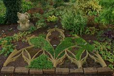 Decorative pattern garden design using Gothic architectural inspiration.