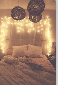 christmas lights + sheer curtain bed backdrop headboard