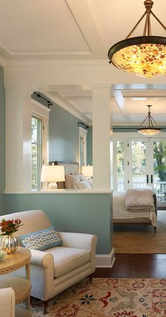 Love the sitting area, the colors, the rug, and the overhead light.  Also like the half wall separating the sleeping area from the sitting area.