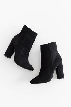 """High ankle booties with a faux suede texture. Side zipper for easy on and off closure. Heel height measures approx. 4"""" Slightly pointed toe. This style runs sma"""