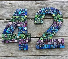 We are the owners of Sweet Dreams Apartment and Piece by Piece Mosaics. Mosaic Madness, Art Deco Home, House Numbers, Clay, Symbols, Letters, Crafts, Decor, Mosaic Ideas
